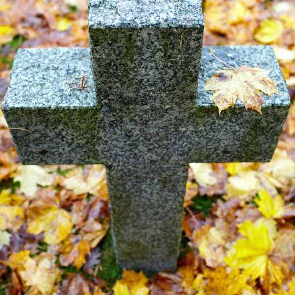 High angle of tombstone cross. Cemetery of German soldiers in Toila, Estonia. Autumn.